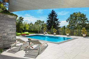 time-to-reseal-all-of-the-natural-stone-and-precast-on-your-project-mid-city-custom-pools