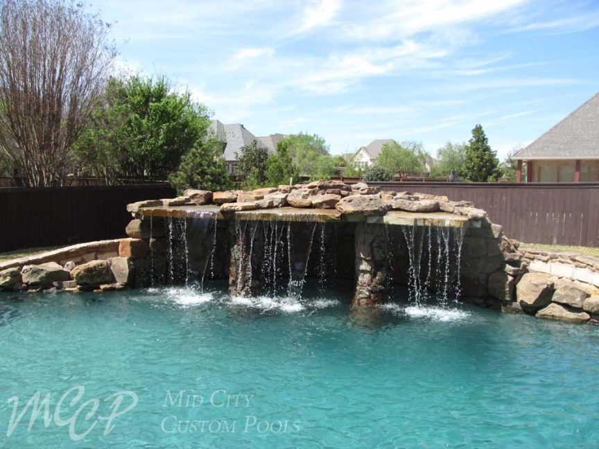 Why You Should Add a Water Feature - Mid City Custom Pools