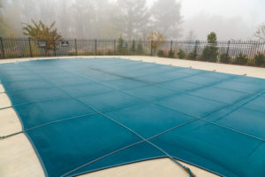 The Importance of Investing in a Good Pool Cover - Mid City Custom Pools